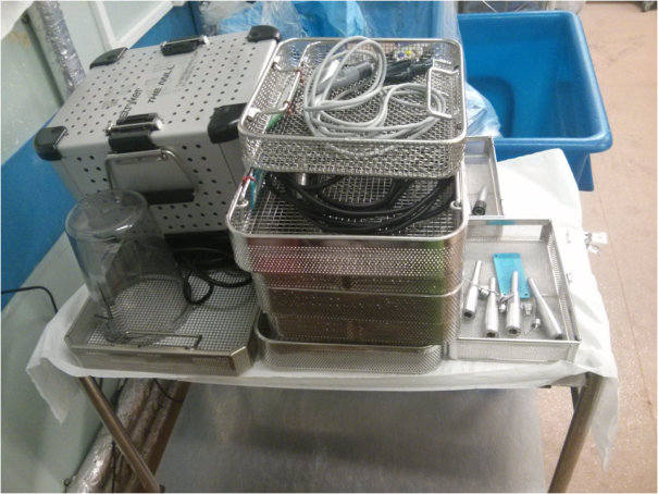 Image of sorted, manually-washed medical items.